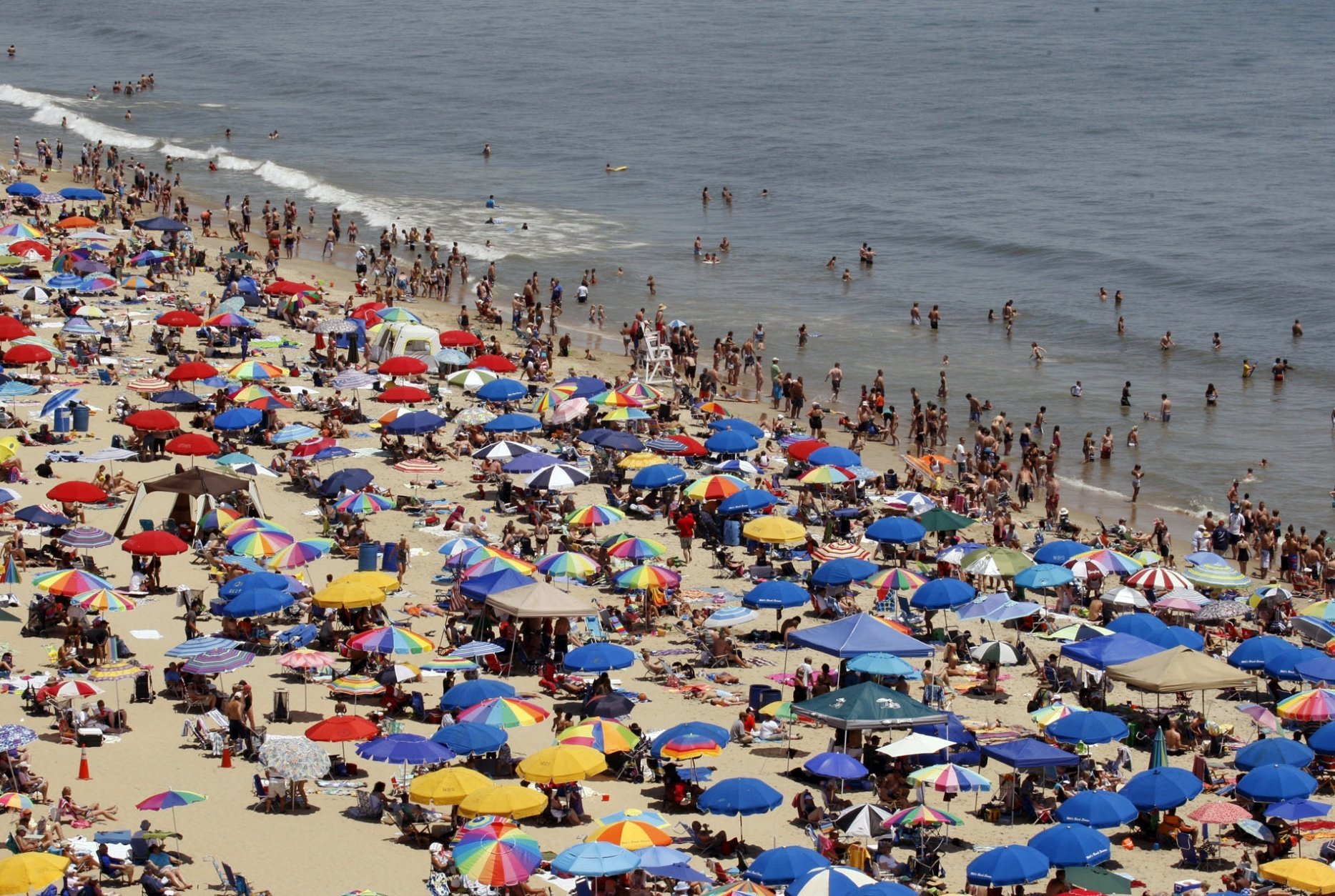 FILE - In this June 9, 2012, file photo, people crowd the beach in Ocean City, Md.  (Amanda Rippen White/The News Journal via AP, File)