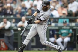 Colorado Rockies' Charlie Blackmon hits a solo home run off Seattle Mariners starting pitcher Felix Hernandez during the first inning of a baseball game, Friday, July 6, 2018, in Seattle. (AP Photo/Stephen Brashear)