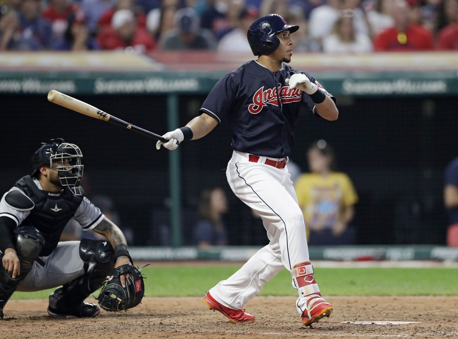 Cleveland Indians' Michael Brantley watches his ball after hitting a one-run double in the seventh inning of a baseball game against the Chicago White Sox, Tuesday, June 19, 2018, in Cleveland. Rajai Davis scored on the play. Catcher Omar Narvaez watches. (AP Photo/Tony Dejak)