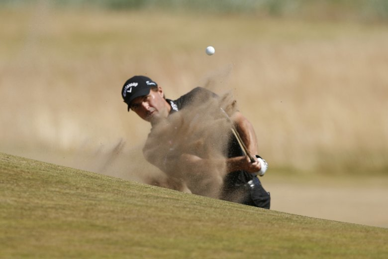 34919faf87aef5 Kevin Kisner of the US plays out of the bunker on the 17th hole during the  first round of the British Open Golf Championship in Carnoustie