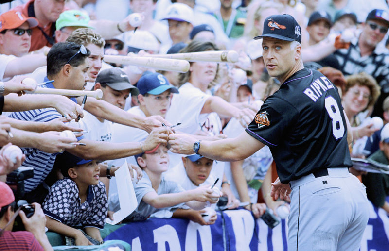 DENVER - JULY 7:  Cal Ripken Jr. of the American League signs autographs for fans during the MLB All-Star Game at Coors Field on July 7, 1998 in Denver, Colorado.  The American League defeated the National League 13-8.  (Photo by: Jed Jacobsohn/Getty Images)