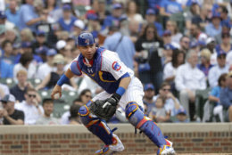 Chicago Cubs catcher Willson Contreras checks the runner at first during the sixth inning of a baseball game against the Los Angeles Dodgers Wednesday, June 20, 2018, in Chicago. (AP Photo/Charles Rex Arbogast)