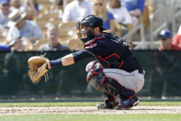 Cleveland Indians catcher Yan Gomes catches during warmups during the third inning of a spring training baseball game against the Los Angeles Dodgers, Thursday, March 1, 2018, in Glendale, Ariz. (AP Photo/Carlos Osorio)