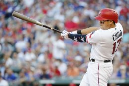 Texas Rangers' Shin-Soo Choo swings for a single during the fourth inning of the team's baseball game against the Houston Astros, Wednesday, July 4, 2018, in Arlington, Texas. Houston won 5-4 in t10 innings. (AP Photo/Brandon Wade)