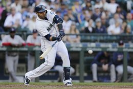 Seattle Mariners' Nelson Cruz hits an RBI single against the Boston Red Sox during the third inning of a baseball game Saturday, June 16, 2018, in Seattle. (AP Photo/John Froschauer)