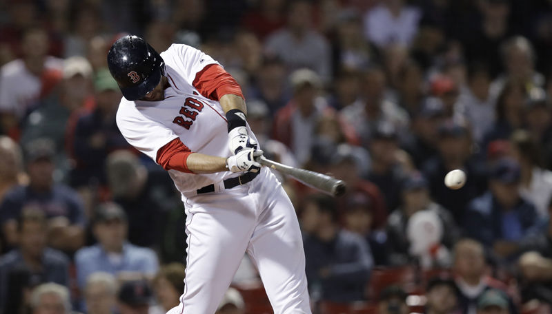 Boston Red Sox's J.D. Martinez takes a swing during the seventh inning of a baseball game at Fenway Park in Boston, Wednesday, June 27, 2018. (AP Photo/Charles Krupa)