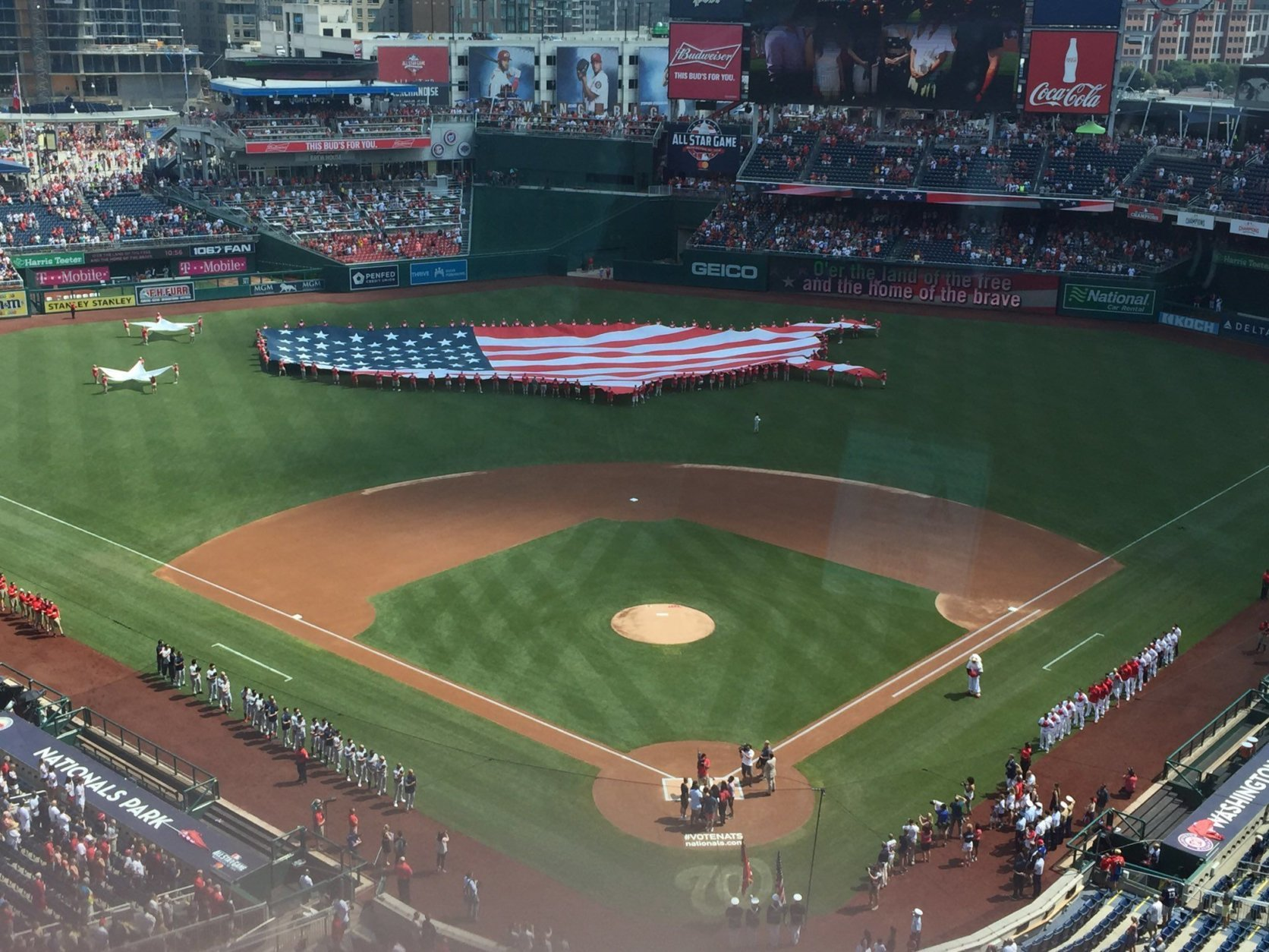 A flag in the shape of the United States is seen at Nationals Park in D.C. on Fourth of July 2018. (WTOP/Jonathan Warner)