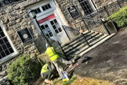 Crews are working to restore the entrance to the Howard County Welcome Center on Ellicott City's Main Street. (WTOP/Neal Augenstein)