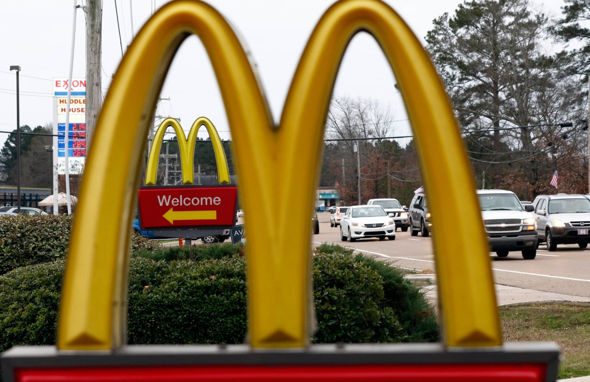FILE - This Feb. 15, 2018, file photo shows a McDonald's Restaurant in Brandon, Miss. Seven national fast-food chains have agreed to end policies that block workers from changing branches, limiting their wages and job opportunities, under the threat of legal action from the state of Washington. Washington Attorney General Bob Ferguson announced the binding agreements with companies including Arby's, Jimmy John's and Cinnabon, at a news conference Thursday, July 12, 2018. McDonald's also signed on, but previously announced plans to end the practice. (AP Photo/Rogelio V. Solis, File)