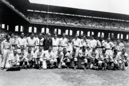 The American League team poses before the first major league All-Star Game in Chicago, July, 6, 1933.  The American League won 4-2.  Front row, from left: Al Schact, Eddie Collins, Tony Lazzeri, General Crowder, Foxx Fletcher, Earl Averill, Ed Rommel, Ben Chapman, Rick Ferrell, Sam West, Charlie Gehringer, bat boy.  Back row, from left: bat boy, unidentified team member, Lou Gehrig, Babe Ruth, Oral Hildebrand, Connie Mack, Joe Cronin, Lefty grove, bat boy, Bill Dickey, Al Simmons, Lefty Gomez, Wes Ferrell, Jimmy Dykes, club boy. (AP Photo)