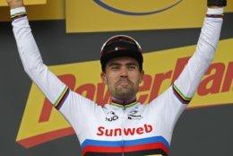 Stage winner Netherlands' Tom Dumoulin flashes two thumbs up on the podium after the twentieth stage of the Tour de France cycling race, an individual time trial over 31 kilometers (19.3 miles)with start in Saint-Pee-sur-Nivelle and finish in Espelette, France, Saturday July 28, 2018. (AP Photo/Christophe Ena )