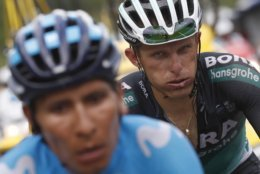 Colombia's Nairo Quintana, left, and Poland's Rafal Majka climb Col du Portet pass during the seventeenth stage of the Tour de France cycling race over 65 kilometers (40.4 miles) with start in Bagneres-de-Luchon and finish in Saint-Lary-Soulan, Col du Portet pass, France, Wednesday July 25, 2018. The Tour de France thinks it has some solutions to liven up the action with today's shorter mountain stage with three grueling climbs, including an uphill finish, intermediate bonus sprints, and a Formula One-like grid start. (AP Photo/Christophe Ena )