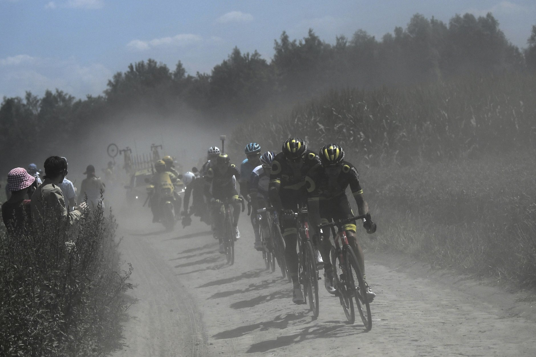 A nine-men breakaway rides in a cloud of dust on a cobblestone section of the ninth stage of the Tour de France cycling race over 156.5 kilometers (97.2 miles) with start in Arras and finish in Roubaix, France, Sunday, July 15, 2018. (Jeff Pachoud, pool photo via AP))