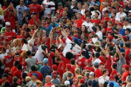WASHINGTON, DC - JULY 16: Fans try to catch a home run hits a by Rhys Hoskins of the Philadelphia Phillies and the National League during the T-Mobile Home Run Derby at Nationals Park on July 16, 2018 in Washington, DC.  (Photo by Patrick McDermott/Getty Images)