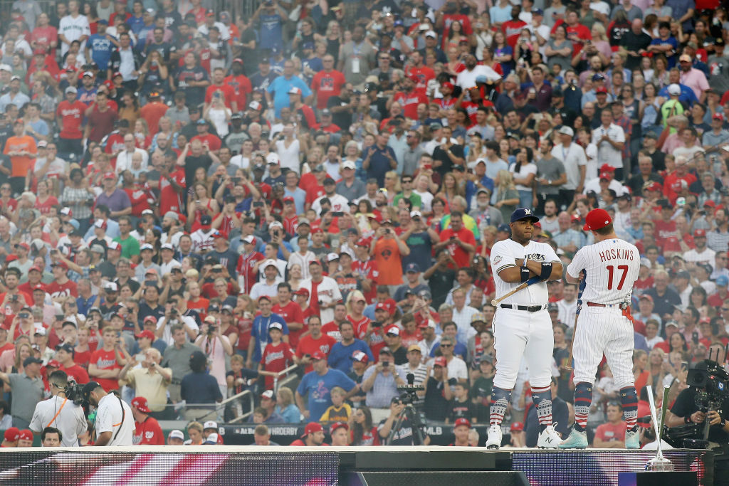 WASHINGTON, DC - JULY 16: Jesus Aguilar of the Milwaukee Brewers and American League and Rhys Hoskins of the Philadelphia Phillies and National League prepare to compete in the first round during the T-Mobile Home Run Derby at Nationals Park on July 16, 2018 in Washington, DC.  (Photo by Rob Carr/Getty Images)