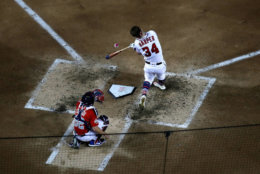 WASHINGTON, DC - JULY 16:  Bryce Harper of the Washington Nationals and National League hits his final home run to win the T-Mobile Home Run Derby at Nationals Park on July 16, 2018 in Washington, DC. Harper defeated Kyle Schwarber of the Chicago Cubs and National League 19-18.  (Photo by Patrick McDermott/Getty Images)