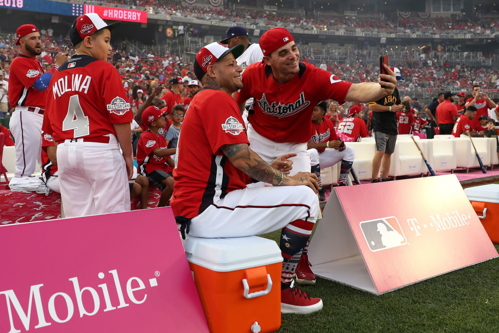 WASHINGTON, DC - JULY 16: Yadier Molina #4 of the St. Louis Cardinals and the National League poses with Scooter Gennett #3 of the Cincinnati Reds and the National League during the T-Mobile Home Run Derby at Nationals Park on July 16, 2018 in Washington, DC.  (Photo by Patrick Smith/Getty Images)
