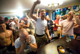 MANCHESTER, ENGLAND - JULY 03:  Fans celebrate as England win on penalties during the FIFA 2018 World Cup Finals match between Colombia and England at The Lord Stamford public house in Manchester on July 3, 2018 in London, England. World Cup fever is building among England fans after reaching the Round of 16 in Russia.  (Photo by Anthony Devlin/Getty Images)