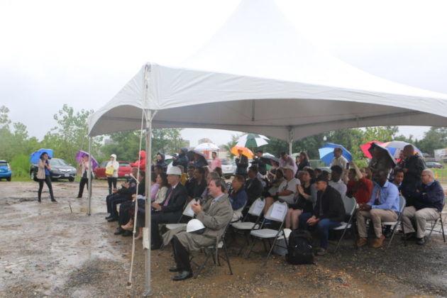 Attendees dodge raindrops at the Long Bridge Park aquatics center groundbreaking. (ARLNow.com)
