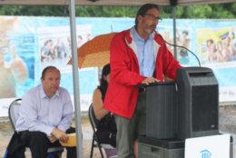 Former County Board member Jay Fisette speaks at the Long Bridge Park aquatics center groundbreaking. (ARLNow.com)