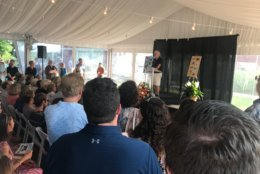 Rob Hiaasen, one of five Capital Gazette staff members killed in last week's newsroom shooting in Annapolis, Maryland, was remembered Monday night by family and friends in a Celebration of Life service. (WTOP/Dick Uliano)