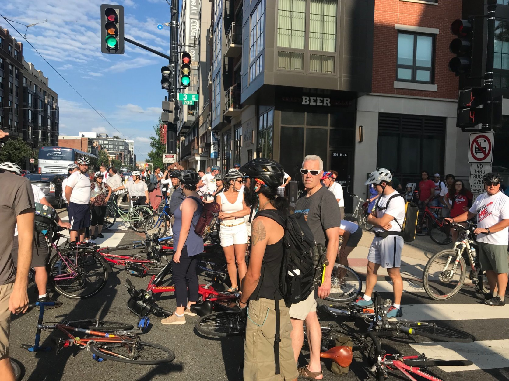 During the short memorial and protest, car horns honked and a few drivers cursed as they saw the crowd of bicyclists causing the momentary slow down. (WTOP/Dick Uliano)