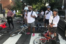 During the Tuesday evening rush hour, dozens of bicyclists laid down their bikes in a brief, silent protest around H and 3rd streets in Northeast D.C. (WTOP/Dick Uliano)