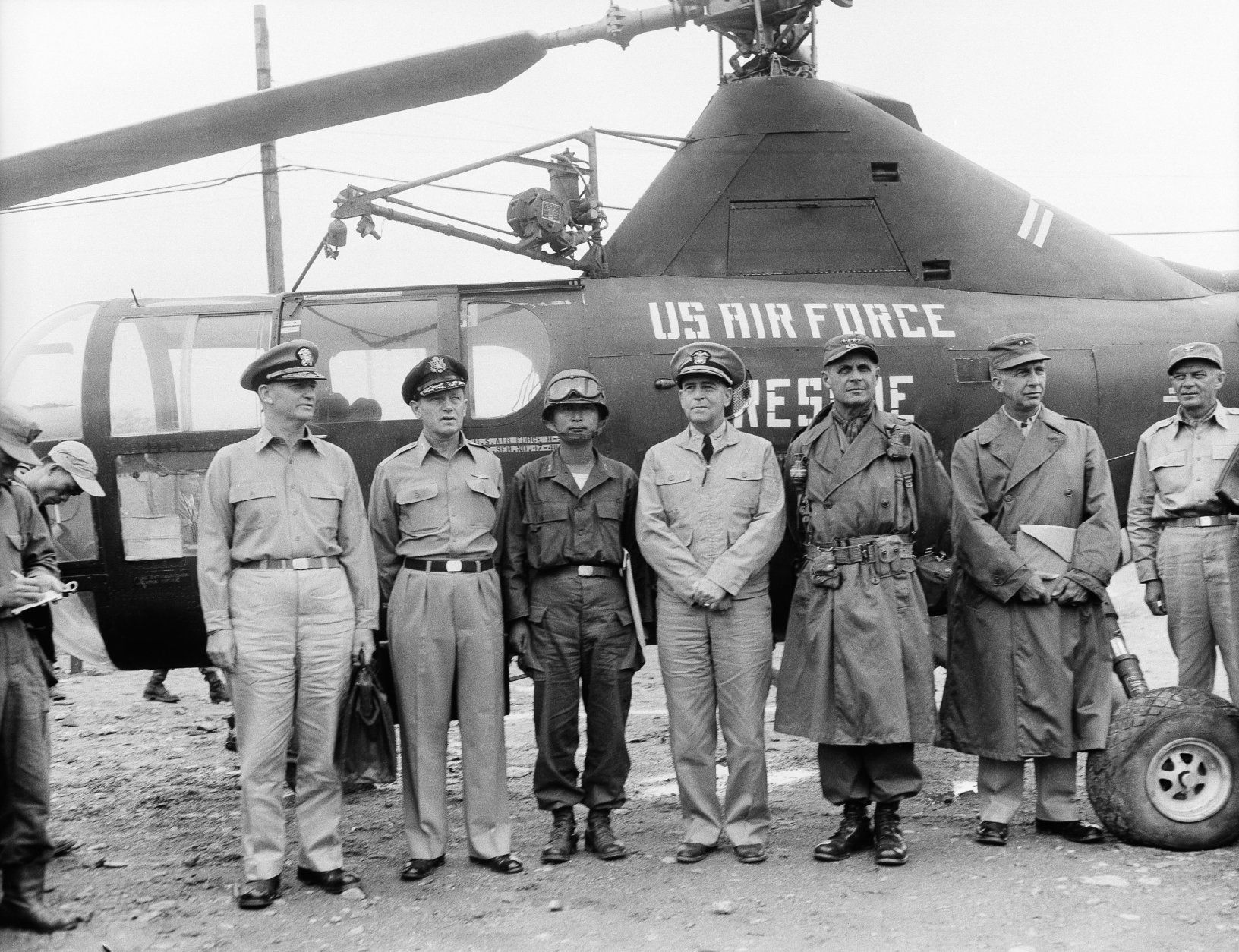 Gen. Matthew B. Ridgway, Supreme Commander (second from right), stands, with United Nations? negotiators before their departure from advance base camp in South Korea for peace conference at Kaesong, July 10, 1951. From left: rear Adm. Arleigh Burke; Maj. Gen. L.C. Craigie; Gen. Paik Sun Yup, South Korean Army; Vice Adm. C. Turner Joy, Senior Negotiator; Gen. Ridgway, and Maj. Gen. Henry I. Hodes. (AP Photo/Jim Pringle)