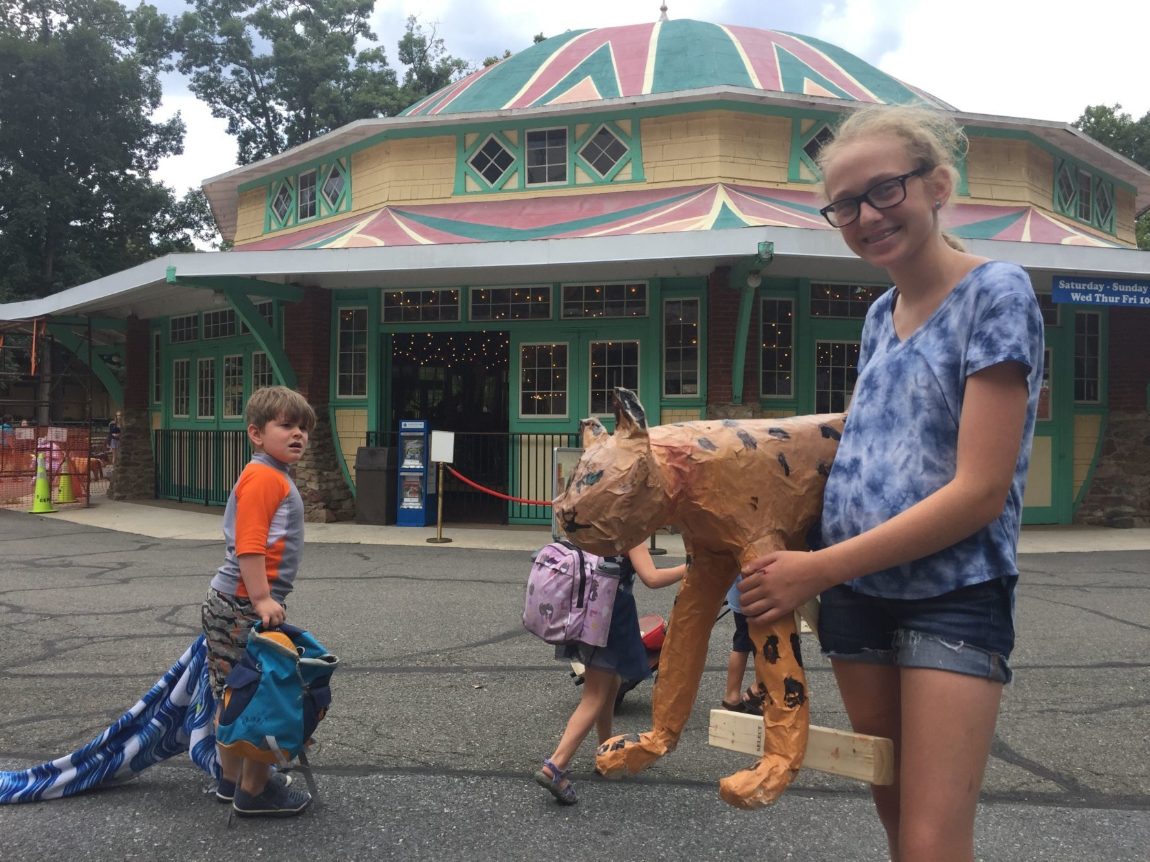 Claira Baisinger Rosen of Bethesda, Maryland, thinks Glen Echo Park is great because of all the different camps where kids can make a lot of different art. She created the paper mache leopard attending Carousel Animals Camp For Teens. (WTOP/Kristi King)