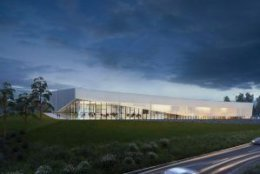 This rendering shows the exterior view of the aquatics center at night. (Courtesy ARLNow/Chris Teale)