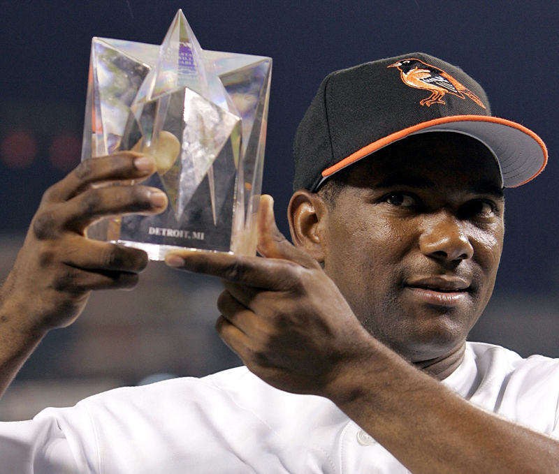 American League All-Star Miguel Tejada of the Baltimore Orioles holds the MVP trophy after the American League defeated the National League 7-5 in the 2005 MLB All-Star Game at Comerica Park in Detroit, Tuesday, July 12, 2005.  (AP Photo/Paul Sancya)