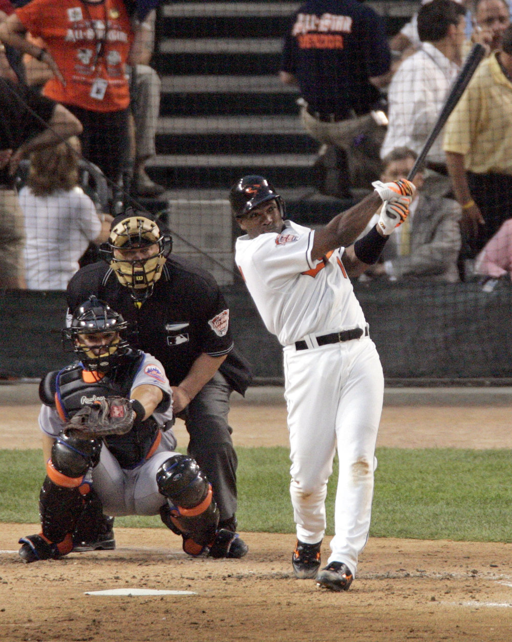American League All-Star Miguel Tejada of the Baltimore Orioles follows through on his second inning home run off National League All-Star pitcher John Smoltz of the Atlanta Braves in the second inning of the 2005 MLB All-Star Game, at Comerica Park in Detroit, Tuesday, July 12, 2005. In the background are catcher Paul Lo Duca of the Florida Marlins and umpire Joe West.  (AP Photo/Charlie Neibergall)