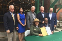 Signing the new 10-year agreement are National Park Service National Capital Regional Director Lisa Mendelson-Ielmini and Montgomery County Executive Ike Leggett. (WTOP/Kristi King)