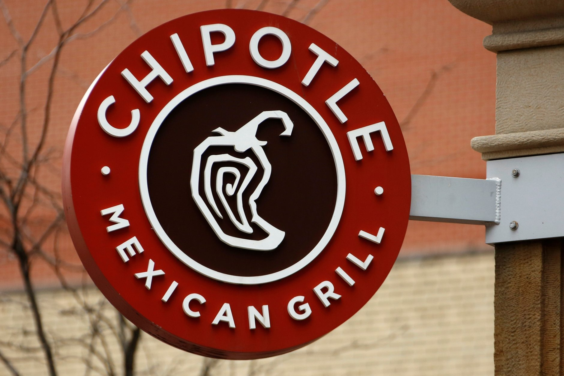 "FILE - This Jan. 12, 2017, file photo shows the sign on a Chipotle restaurant in Pittsburgh. Chipotle is not giving away $100 gift cards for National Avocado Day on Tuesday, July 31, 2018, or any other day for that matter. The false offer, which has been circulating widely on social media in recent days, provides a link that takes users to a page that reads ""National Avocado Day Get a $100 Chipotle Card."" (AP Photo/Gene J. Puskar, File)"