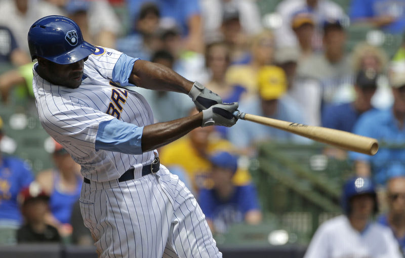 Milwaukee Brewers' Lorenzo Cain hits an RBI-double during the third inning of a baseball game against the Philadelphia Phillies, Sunday, June 17, 2018, in Milwaukee. (AP Photo/Aaron Gash)