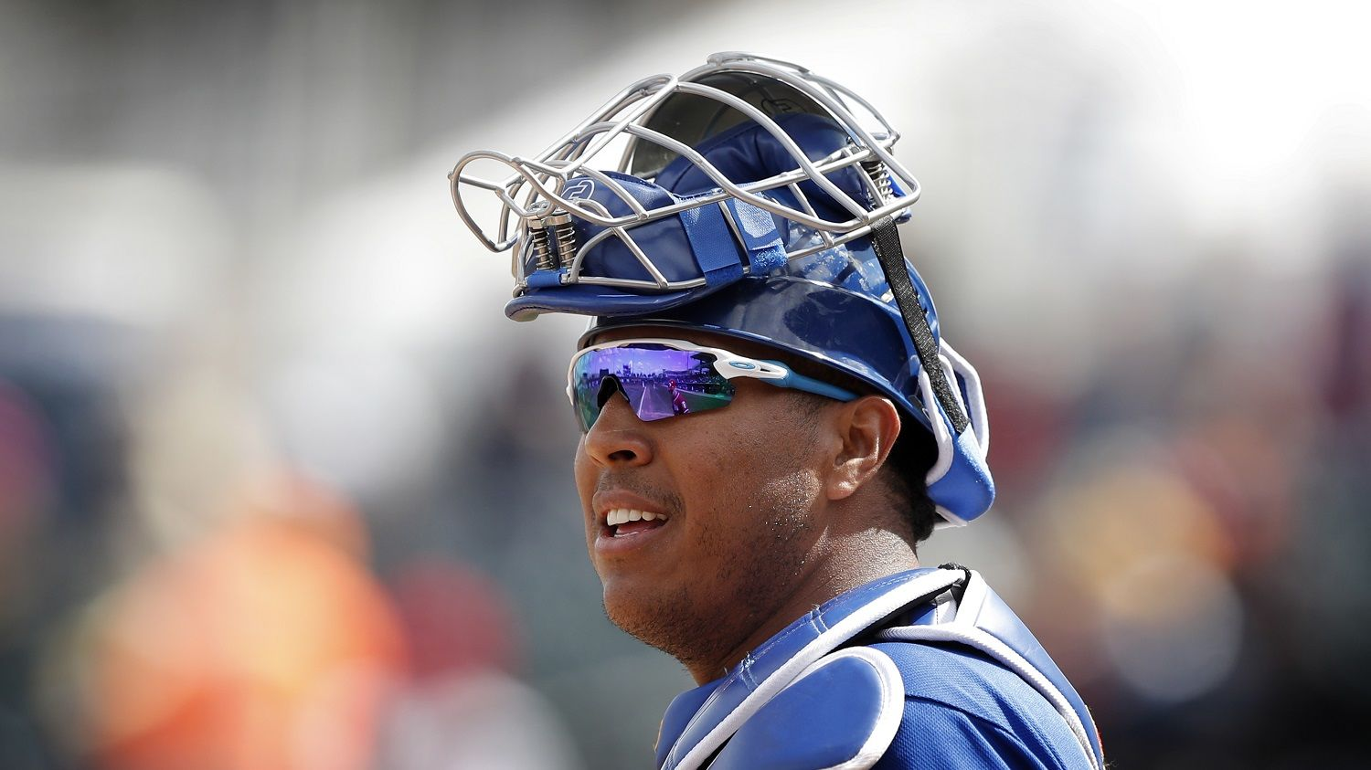 Kansas City Royals catcher Salvador Perez gets ready for a pitch during the first inning of a spring training baseball game against the Cincinnati Reds, Wednesday, Feb. 28, 2018, in Surprise, Ariz. (AP Photo/Charlie Neibergall)