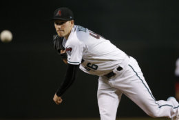 Arizona Diamondbacks starting pitcher Patrick Corbin warms up during the first inning of a baseball game against the San Francisco Giants Friday, June 29, 2018, in Phoenix. (AP Photo/Ross D. Franklin)