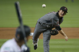 Arizona Diamondbacks' Zack Greinke pitches to Miami Marlins' Starlin Castro during the first inning of a baseball game, Thursday, June 28, 2018, in Miami. (AP Photo/Wilfredo Lee)