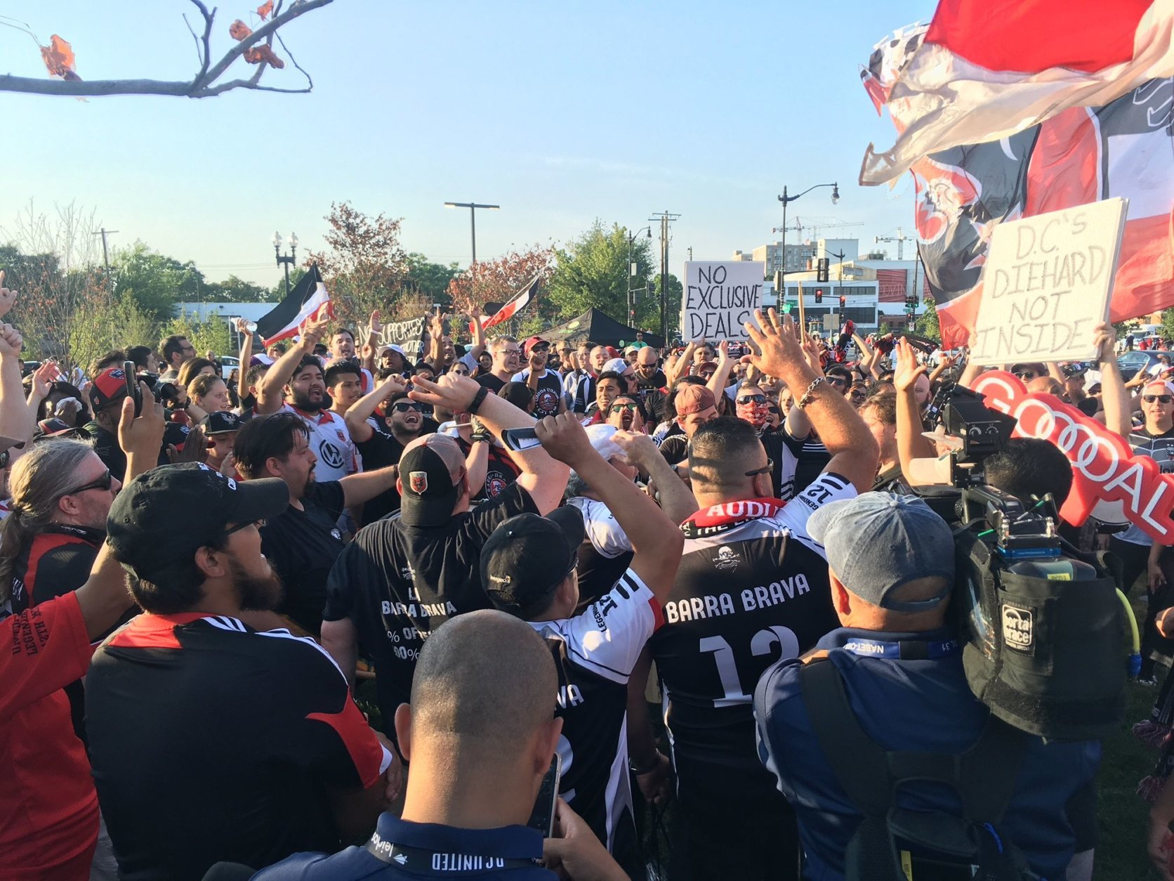 Members of La Barra Brava and District Ultras supporters groups protest outside the stadium before the game. (WTOP/Noah Frank)