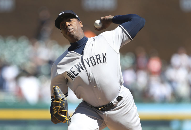 New York Yankees relief pitcher Aroldis Chapman throws during the ninth inning of the first game of a baseball doubleheader against the Detroit Tigers, Monday, June 4, 2018, in Detroit. (AP Photo/Carlos Osorio)