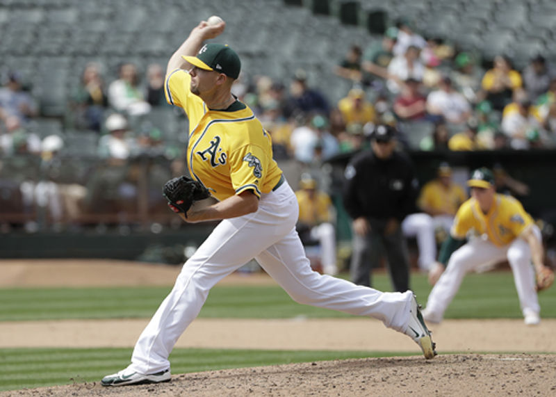 Oakland Athletics pitcher Blake Treinen throws against the Baltimore Orioles during the ninth inning of a baseball game in Oakland, Calif., Sunday, May 6, 2018. The Athletics won 2-1. (AP Photo/Jeff Chiu)