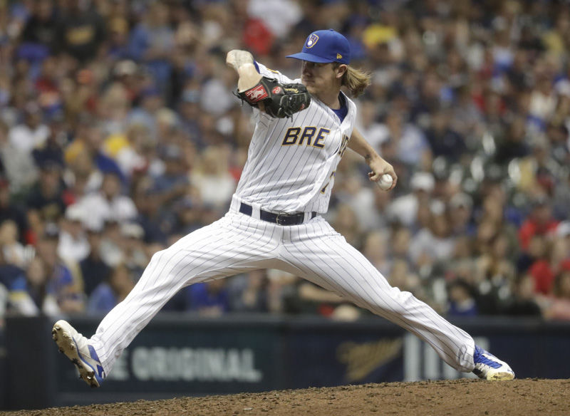 Milwaukee Brewers' Josh Hader throws during the sixth inning of a baseball game against the St. Louis Cardinals Friday, June 22, 2018, in Milwaukee. (AP Photo/Morry Gash)