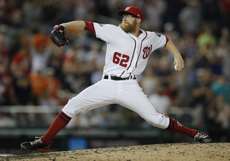 Washington Nationals relief pitcher Sean Doolittle throws during the ninth inning of the team's baseball game against the Baltimore Orioles at Nationals Park, Thursday, June 21, 2018, in Washington. The Nationals won 4-2. (AP Photo/Carolyn Kaster)