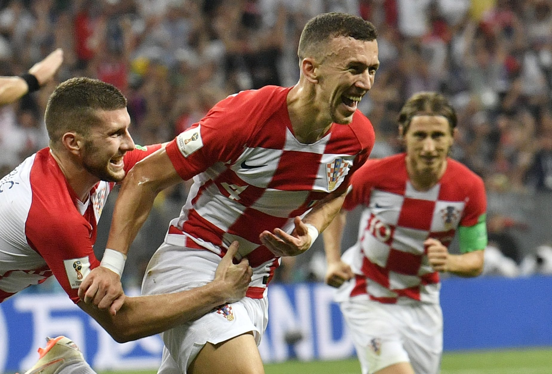 Croatia's Ivan Perisic, center, celebrates after scoring his side's opening goal during the final match between France and Croatia at the 2018 soccer World Cup in the Luzhniki Stadium in Moscow, Russia, Sunday, July 15, 2018. (AP Photo/Martin Meissner)