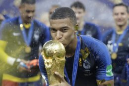 France's Kylian Mbappe kisses the trophy after the final match between France and Croatia at the 2018 soccer World Cup in the Luzhniki Stadium in Moscow, Russia, Sunday, July 15, 2018. France won the final 4-2. (AP Photo/Matthias Schrader)