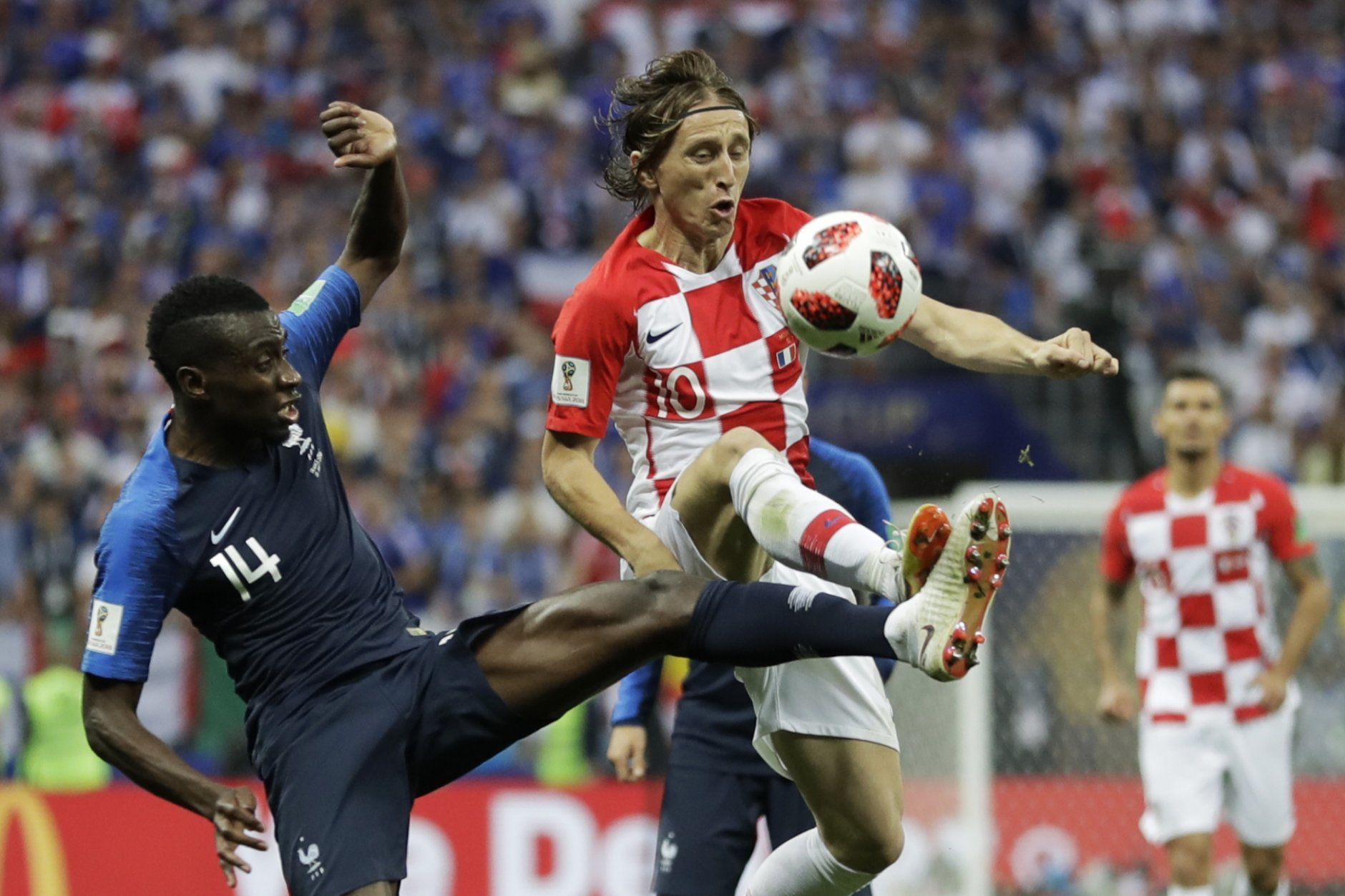 Croatia's Luka Modric, right, vies for the ball with France's Blaise Matuidi, left, during the final match between France and Croatia at the 2018 soccer World Cup in the Luzhniki Stadium in Moscow, Russia, Sunday, July 15, 2018. (AP Photo/Matthias Schrader)