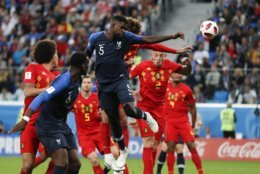 France's Samuel Umtiti, (5) heads the ball to score the opening goal of the game during the semifinal match between France and Belgium at the 2018 soccer World Cup in the St. Petersburg Stadium in, St. Petersburg, Russia, Tuesday, July 10, 2018. (AP Photo/Natacha Pisarenko)