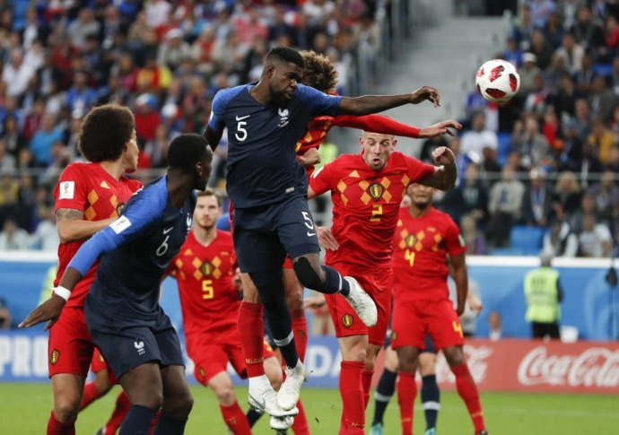 Heads The Ball To Score The Opening Goal Of The Game During The Semifinal Match Between France And Belgium At The  Soccer World Cup In The St