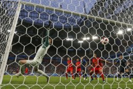 Belgium goalkeeper Thibaut Courtois is beaten by a header from France's Samuel Umtiti for the opening goal during the semifinal match between France and Belgium at the 2018 soccer World Cup in the St. Petersburg Stadium, in St. Petersburg, Russia, Tuesday, July 10, 2018. (AP Photo/Natacha Pisarenko)