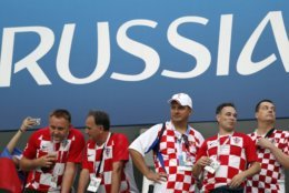 Croatian fans wait prior the quarterfinal match between Russia and Croatia at the 2018 soccer World Cup in the Fisht Stadium, in Sochi, Russia, Saturday, July 7, 2018. (AP Photo/Rebecca Blackwell)
